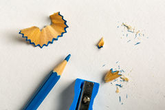 Blue pencil, sharpener and shavings Stock Image