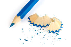 Blue pencil and shavings. Isolated on white background royalty free stock images