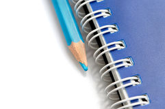 Blue pencil and spiral of notebook Stock Images
