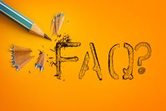 The blue pencil on yellow orange background with FAQ text word , Stock Photo