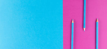 Blue pencils arranged on purple and blue contrast background. Blue pencils arranged on two colors blue and purple contrast background Royalty Free Stock Image