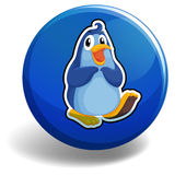 Blue penguin on round badge Stock Images