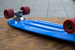 Blue Penny Board on Wooden Table Stock Image