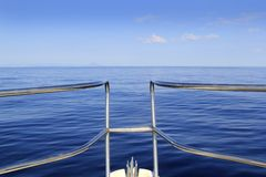 Blue perfect sea cruising boat bow calm ocean Royalty Free Stock Images