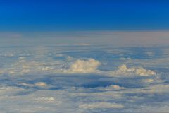 Blue perfect sky sea of clouds from high altitude space. Clouds from the altitude of the plane Blue perfect sky sea of clouds from high altitude space background Stock Photo