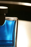 Blue perfume bottle. In a backlight Royalty Free Stock Photography