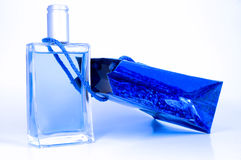 Blue perfume bottle and blue pack. Isolated on white background Royalty Free Stock Images