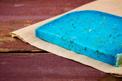 Blue pesto cheese with herbs on wooden rustic background Royalty Free Stock Photo
