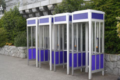 Blue Phone Booths. A row of four identical phone booths Stock Photography