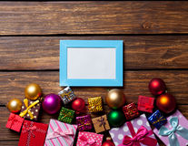 Blue photo frame and christmas gifts Stock Photos