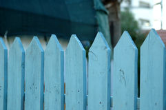 Blue picket fence. Pale blue picket fence royalty free stock image