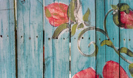 Blue Picket Fence. Colorful, blue picket fence with red flowers Royalty Free Stock Photo