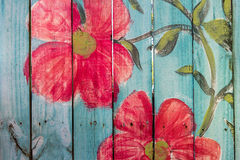 Blue Picket Fence. Colorful, blue picket fence with red flowers Stock Photo