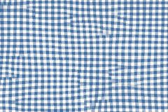 Blue picnic blanket fabric with squared patterns and texture royalty free stock photography