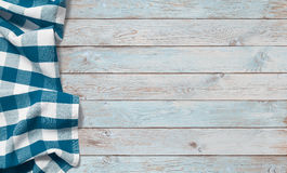Blue picnic cloth on wood table Stock Images