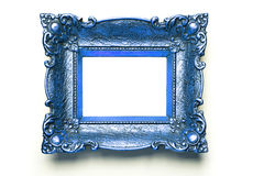 Blue Picture Frame on white wall Stock Photo