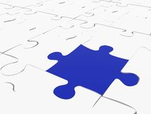 Blue piece on white puzzle Stock Photo