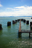 Blue Pier. Blue sky and water surrounds a pier Stock Photos