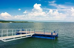 Blue pier on Zemplinska Sirava lake. Beautiful landscape of Slovakia with gorgeous cloudscape. Lovely place for vacation or weekend in summer Royalty Free Stock Photography