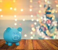 Blue pig bank with Christmas background,  money and saving for c Stock Photos