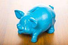 Blue Pig piggy bank. On a table stock photos
