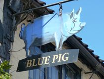 English Pub Sign the Blue Pig. A Blue Pig public house sign taken in Grantham, England, UK Stock Photo