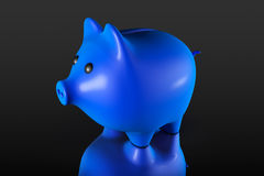 Blue Piggy bank style money box. On a black background Royalty Free Stock Photos