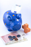 Blue piggy bank on white background Royalty Free Stock Photos