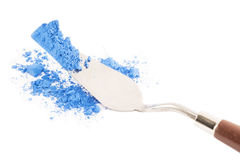 Blue pigment with the painting knife Stock Photos