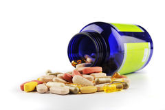 Blue pill bottle and assorted pills Stock Photo