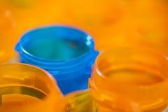 Blue pill bottle offset royalty free stock image