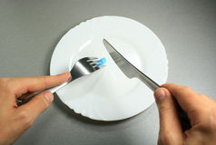 Blue pill meal. Photo of a blue pill on a plate Stock Image