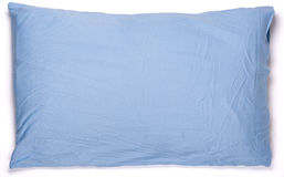 Blue pillow. A blue pillow, isolated on white royalty free stock image