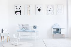Bright bedroom with rocking horse royalty free stock photography
