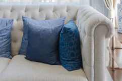 Blue pillow on white sofa in luxury living room Royalty Free Stock Images