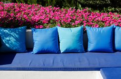 Blue pillows and a sitting place in the garden Royalty Free Stock Image