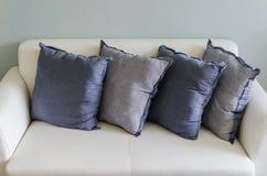 Blue pillows on white leather sofa Royalty Free Stock Photo