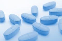 Blue pills. Close-up of blue pills Stock Images