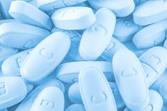 Blue pills as background Royalty Free Stock Images