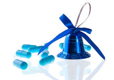 Blue Pills and Decorative Bell Royalty Free Stock Photos