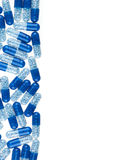 Blue pills isolated on white Stock Images