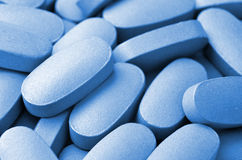 Blue pills Stock Image