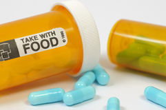Blue pills an pill bottle Royalty Free Stock Photo