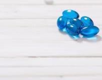Blue  pills  on white background Stock Photo