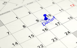 Blue pin marking the 17th on a calendar Stock Images