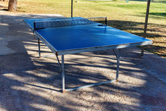 Blue ping pong table on ground Royalty Free Stock Photos
