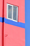 Blue and pink. A small window on wall with pink and blue color shape, shown as geometric shape and color of the architecture Stock Photo