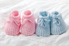 Blue and pink baby booties royalty free stock image