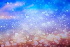 Purple glitter snowflakes defocused bokeh background effect for holiday stock image