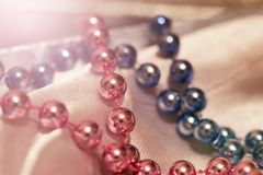Blue and pink beads are very close stock photo